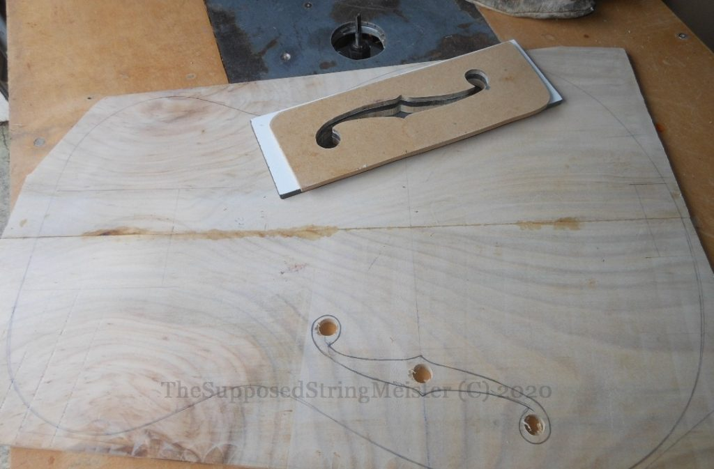 Norfolk Pine guitar top - outline and routing the F holes with template.
