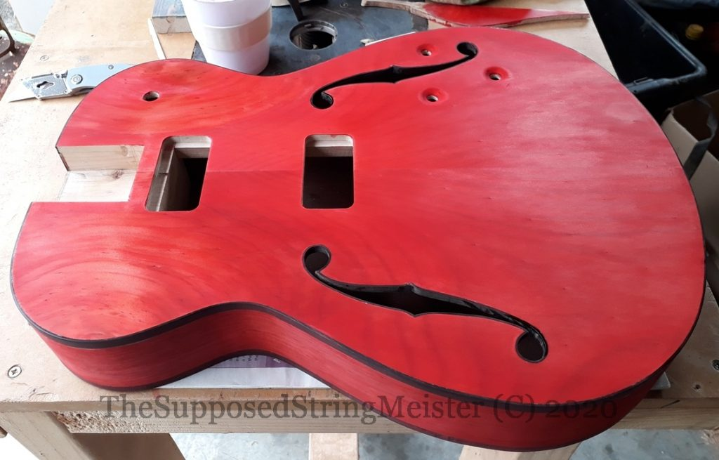 Applying a reddish stain to the Duovette - the guitar Gretsch did not make